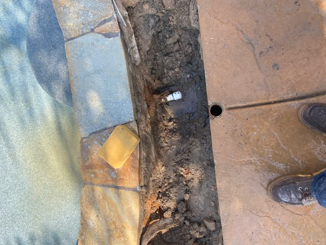 leak next to pool coping plumbing